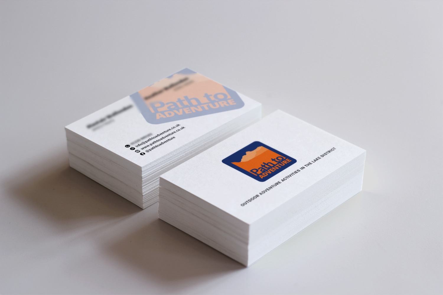Two stacks of business cards